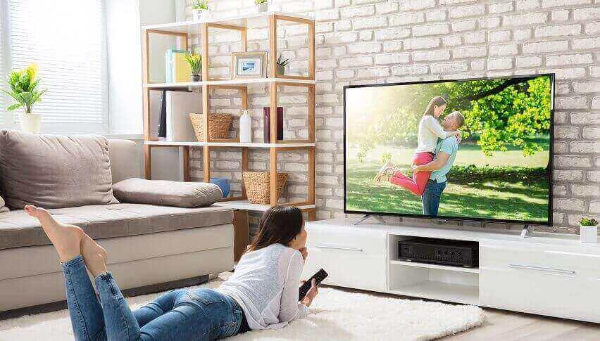 Girl Watching TV Lying on Floor